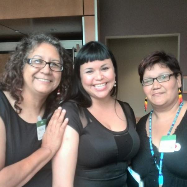 Naomi Sayers (center) with Bridget Tolley (L) and Colleen Cardinal (R) of Families of Sisters in Spirit after the Standing Committee on Justice and Human Rights